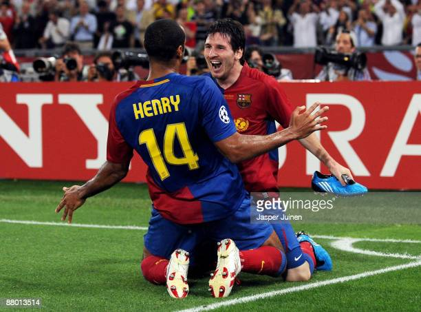 Lionel Messi of Barcelona celebrates with his team mate Thierry Henry after Messi scored the second goal for Barcelona during the UEFA Champions...