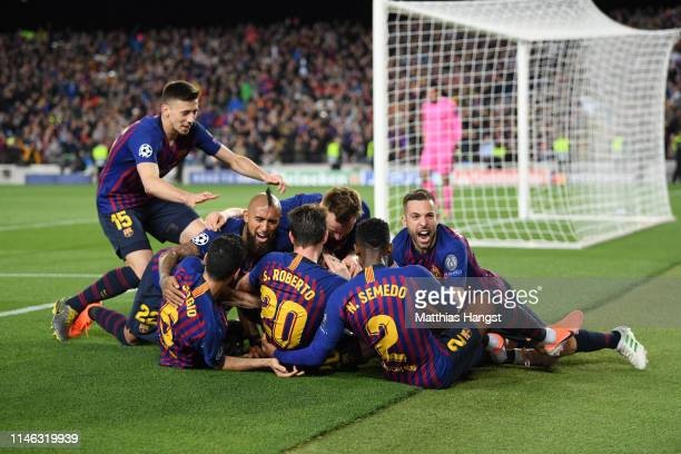 Lionel Messi of Barcelona celebrates with his team mates after he scores his sides third goal during the UEFA Champions League Semi Final first leg...