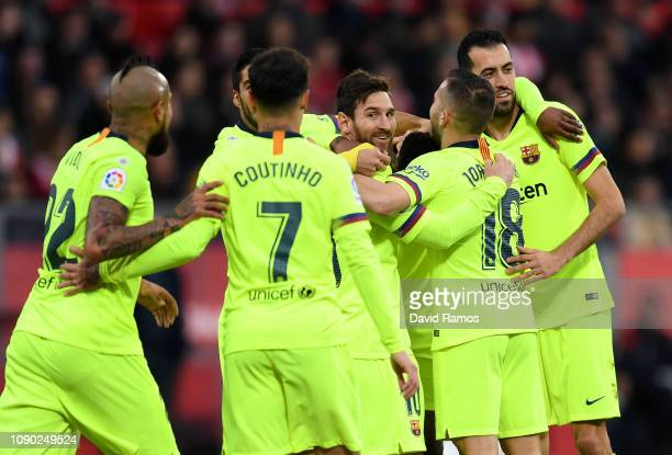 Lionel Messi of Barcelona celebrates with his team mates after Nelson Semedo of Barcelona score the teams first goal during the La Liga match between...