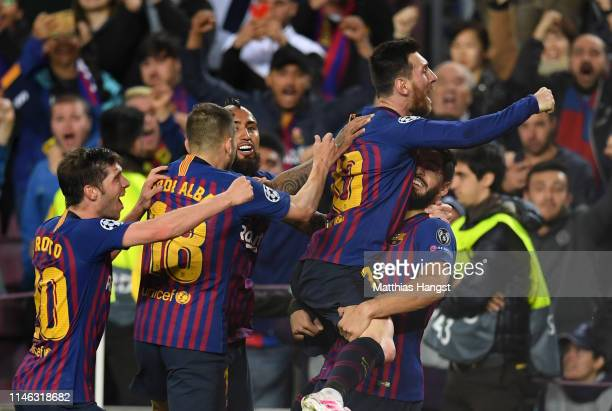 Lionel Messi of Barcelona celebrates with his teammates after he scores his sides second goal during the UEFA Champions League Semi Final first leg...
