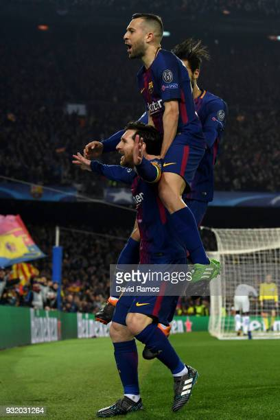 Lionel Messi of Barcelona celebrates with Jordi Alba and Andre Gomes of Barcelona as he scores their third goal during the UEFA Champions League...
