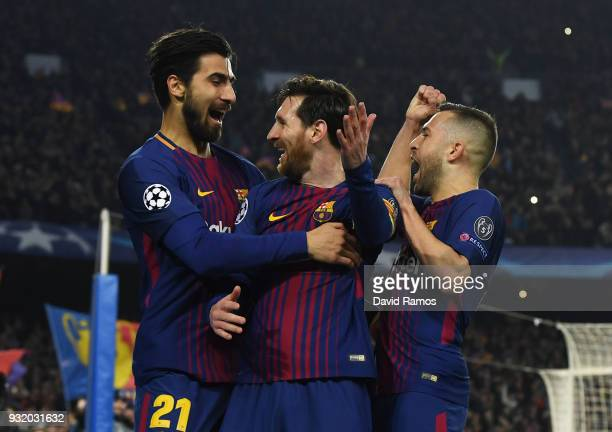 Lionel Messi of Barcelona celebrates with Jordi Alba and Andre Gomes as he scores their third goal during the UEFA Champions League Round of 16...