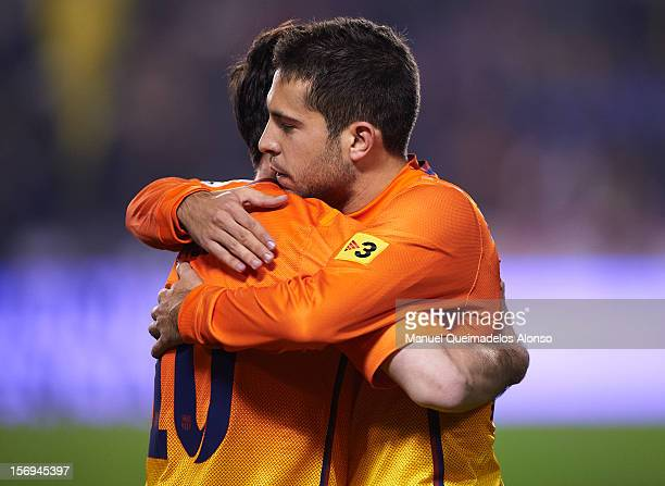 Lionel Messi of Barcelona celebrates with Jordi Alba during the la Liga match between Levante UD and FC Barcelona at Ciutat de Valencia on November...
