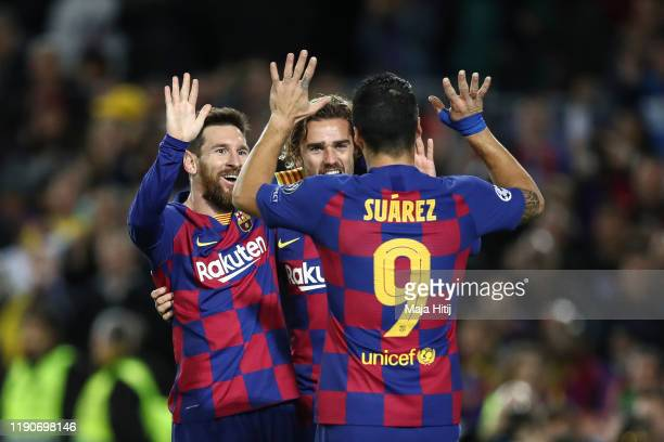 Lionel Messi of Barcelona celebrates with Luis Suarez of Barcelona and Antoine Griezmann of FC Barcelona after scoring his team's second goal during...