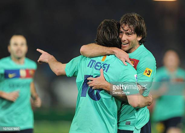 Lionel Messi of Barcelona celebrates with Maxwell after scoring the opening goal during the La Liga match between UD Almeria and Barcelona at Estadio...