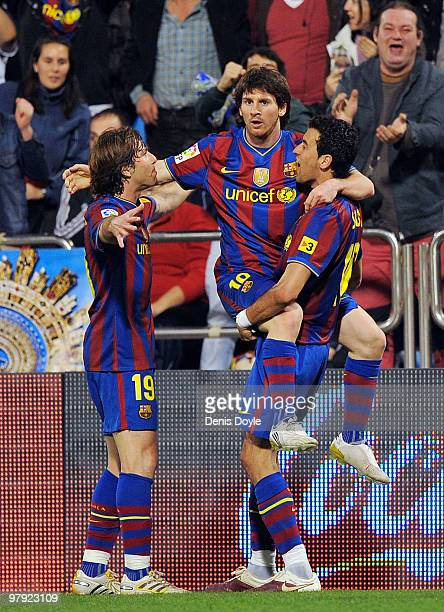Lionel Messi of Barcelona celebrates with Maxwell Scherrer and Sergio Busquets after scoring his team's second goal during the La Liga match between...