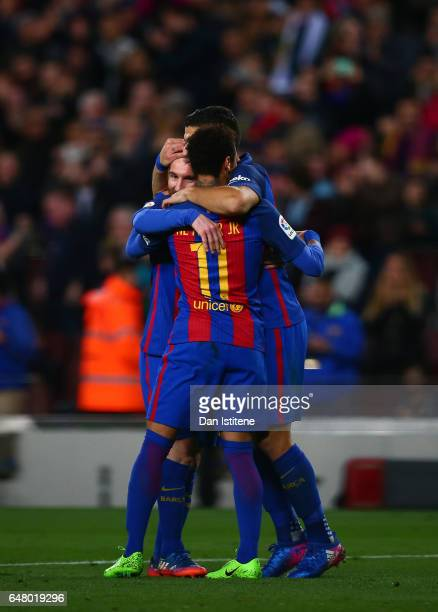 Lionel Messi of Barcelona celebrates with Neymar and Luis Suarez after scoring his team's fifth goal during the La Liga match between FC Barcelona...