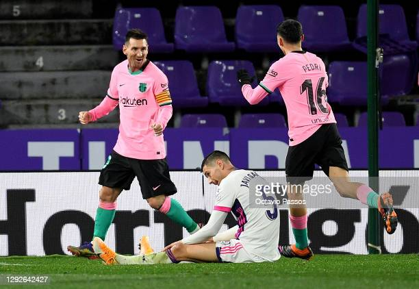 Lionel Messi of Barcelona celebrates with Pedri after scoring his sides third goal as Javier Sanchez of Real Valladolid reacts during the La Liga...
