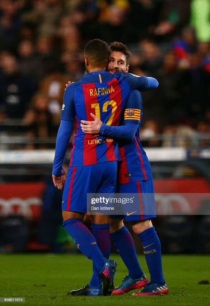 Lionel Messi of Barcelona celebrates with Rafinha after scoring his team's fifth goal during the La Liga match between FC Barcelona and RC Celta de Vigo at the Camp Nou on March 4, 2017 in Barcelona, Spain.