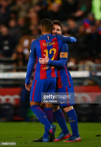 Lionel Messi of Barcelona celebrates with Rafinha after scoring his team's fifth goal during the La Liga match between FC Barcelona and RC Celta de...