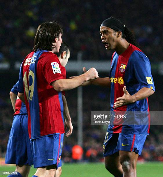 Lionel Messi of Barcelona celebrates with Ronaldinho after scoring Barcelona's 2nd goal during the Primera Liga match between Barcelona and Real...