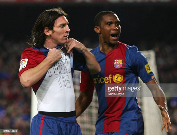 Lionel Messi of Barcelona celebrates with Samuel Eto'o after scoring Barcelona's first goal during the Primera Liga match between Barcelona and Real...