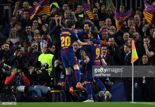 Lionel Messi of Barcelona celebrates with Sergi Roberto and Luis Suarez as he scores their first goal during the UEFA Champions League Round of 16...