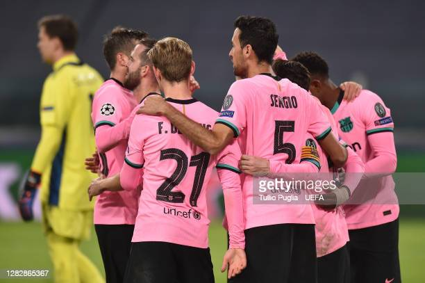 Lionel Messi of Barcelona celebrates with team mates after scoring his sides second goal from the penalty spot during the UEFA Champions League Group...