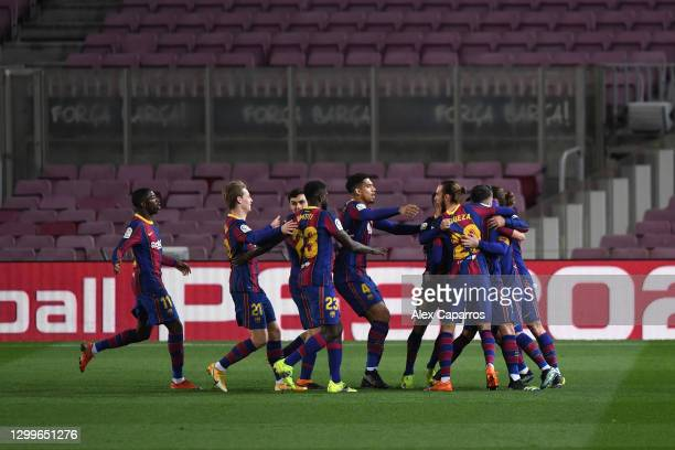 Lionel Messi of Barcelona celebrates with team mates after scoring their side's first goal during the La Liga Santander match between FC Barcelona...
