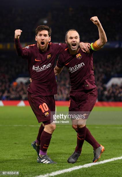 Lionel Messi of Barcelona celebrates with teammate Andres Iniesta after scoring his sides first goal during the UEFA Champions League Round of 16...