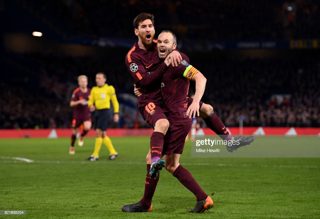 Lionel Messi of Barcelona celebrates with teammate Andres Iniesta after scoring his sides first goal during the UEFA Champions League Round of 16 First Leg match between Chelsea FC and FC Barcelona at Stamford Bridge on February 20, 2018 in London, United Kingdom.