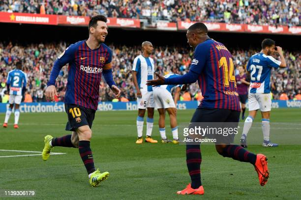 Lionel Messi of Barcelona celebrates with teammate Malcom after scoring his team's second goal during the La Liga match between FC Barcelona and RCD...
