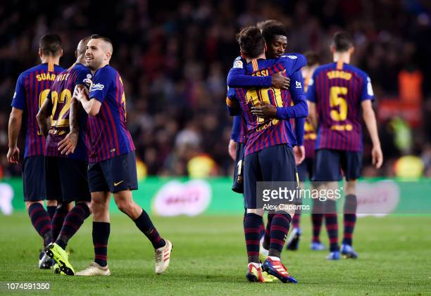 Lionel Messi of Barcelona celebrates with teammate Ousmane Dembele after scoring his team's second goal during the La Liga match between FC Barcelona...