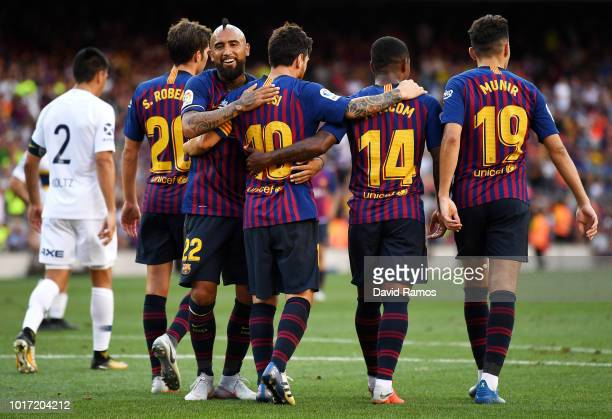 Lionel Messi of Barcelona celebrates with teammates after scoring his team's second goal during the Joan Gamper Trophy between FC Barcelona and Boca...