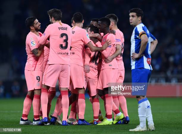 Lionel Messi of Barcelona celebrates with teammates after scoring his team's fourth goal during the La Liga match between RCD Espanyol and FC...