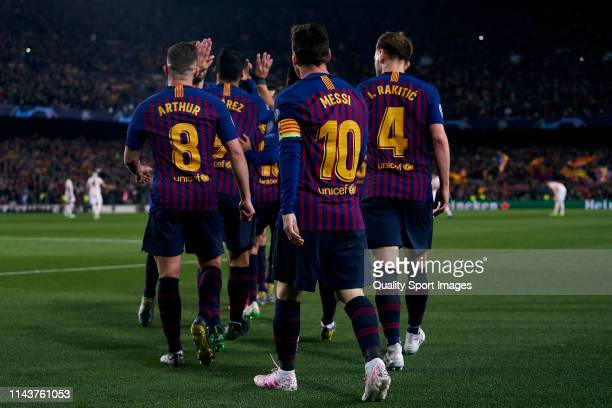 Lionel Messi of Barcelona celebrates with teammates after scoring his first goal during the UEFA Champions League Quarter Final second leg match...