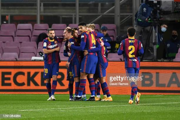 Lionel Messi of Barcelona celebrates with teammates after scoring their team's first goal during the La Liga Santander match between FC Barcelona and...