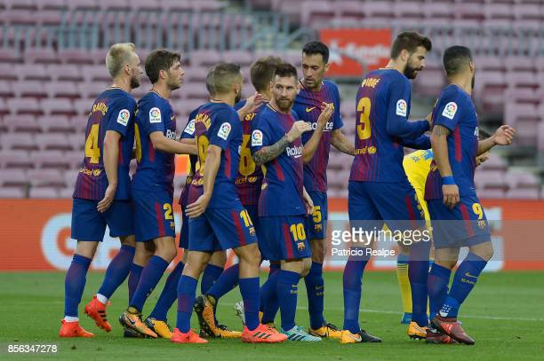 Lionel Messi of Barcelona celebrates with teammates after scoring the second goal of his team during the La Liga match between Barcelona and Las...