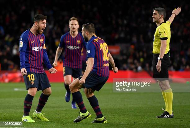 Lionel Messi of Barcelona celebrates with teammates Jordi Alba and Ivan Rakitic after scoring their team's second goal during the La Liga match...