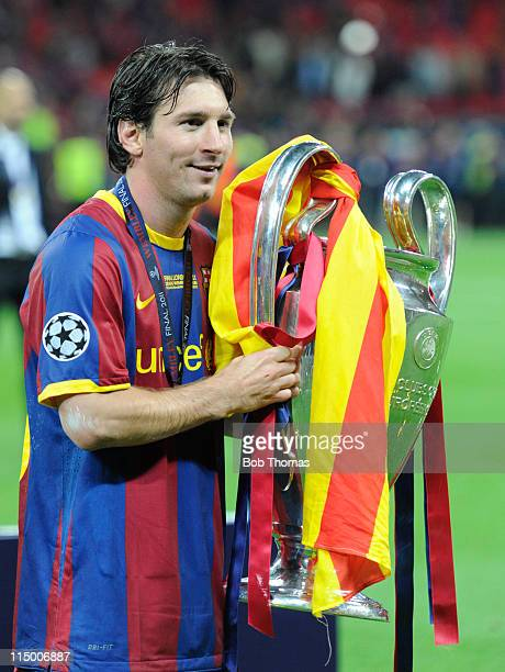 Lionel Messi of Barcelona celebrates with the trophy after the UEFA Champions League final between FC Barcelona and Manchester United FC at Wembley...