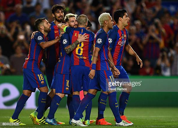 Lionel Messi of Barcelona celebreates scoring his third and his sides fifth goal with team mates during the UEFA Champions League Group C match...