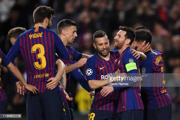 Lionel Messi of Barcelona celerbates scores his team's first goal from a penalty with Jordi Alba and team mates during the UEFA Champions League...