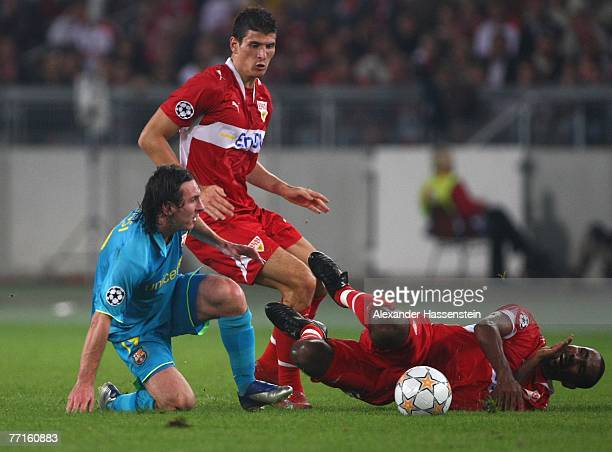 Lionel Messi of Barcelona challenge for the ball with Mario Gomez and his team mate Cacau of Stuttgart during the UEFA Champions League Group E match...