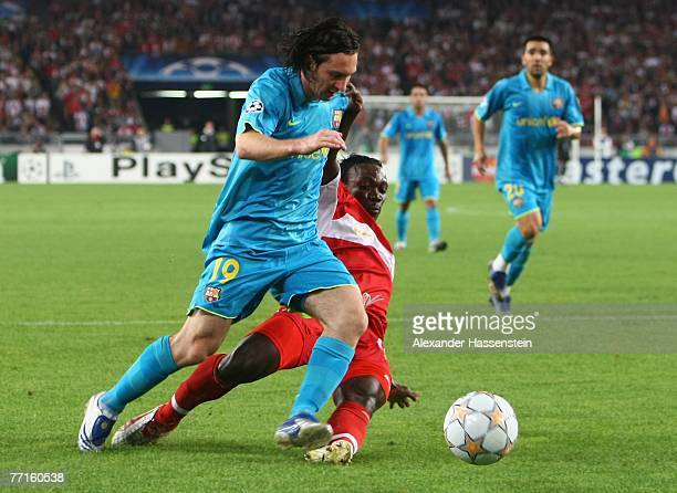 Lionel Messi of Barcelona challenges for the ball with Arthur Boka of Stuttgart during the UEFA Champions League Group E match between VfB Stuttgart...