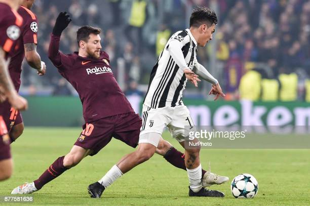 Lionel Messi of Barcelona challenges Paulo Dybala of Juventus during the UEFA Champions League match between Juventus and Barcelona at the Juventus...