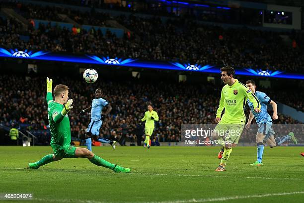 Lionel Messi of Barcelona chips the ball over Man City goalkeeper Joe Hart and scores only to see the goal disallowed during the UEFA Champions...