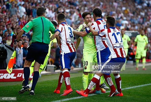 Lionel Messi of Barcelona clashes with Diego Godin of Atletico Madrid during the La Liga match between Club Atletico de Madrid and FC Barcelona at...