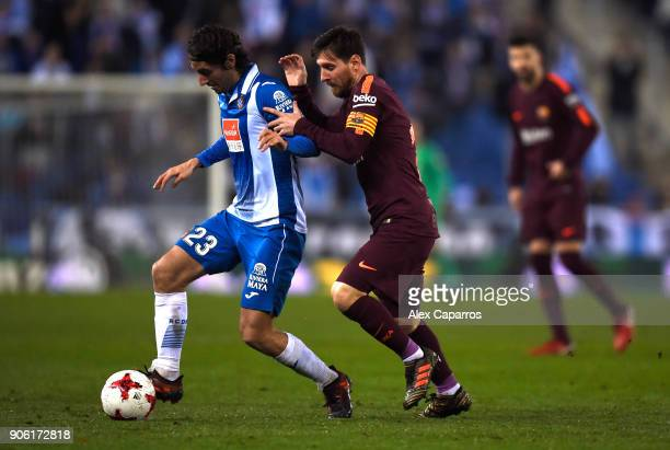 Lionel Messi of Barcelona closes down Esteban Granero of Espanyol during the Spanish Copa del Rey Quarter Final First Leg match between Espanyol and...