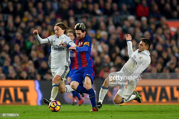 Lionel Messi of Barcelona competes for the ball against Luka Modric and Mateo Kovacic of Real Madrid during the La Liga match between FC Barcelona...