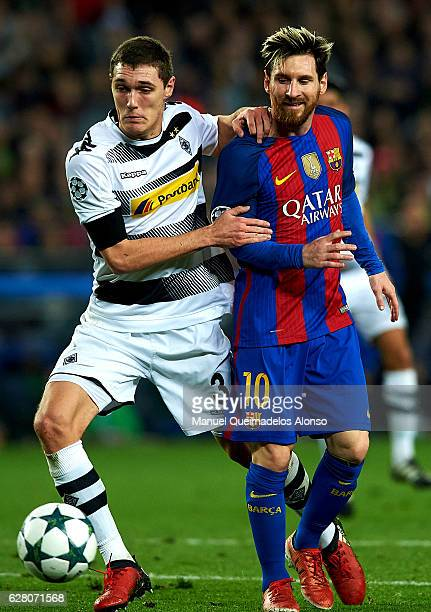 Lionel Messi of Barcelona competes for the ball with Andreas Christensen of Borussia Moenchengladbach during the UEFA Champions League Group C match...