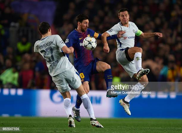 Lionel Messi of Barcelona competes for the ball with Cesar Azpilicueta and Andreas Christensen of Chelsea during the UEFA Champions League Round of...