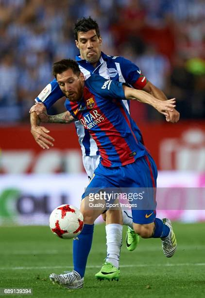 Lionel Messi of Barcelona competes for the ball with Manu Garcia of Deportivo Alaves during the Copa Del Rey Final match between FC Barcelona and...