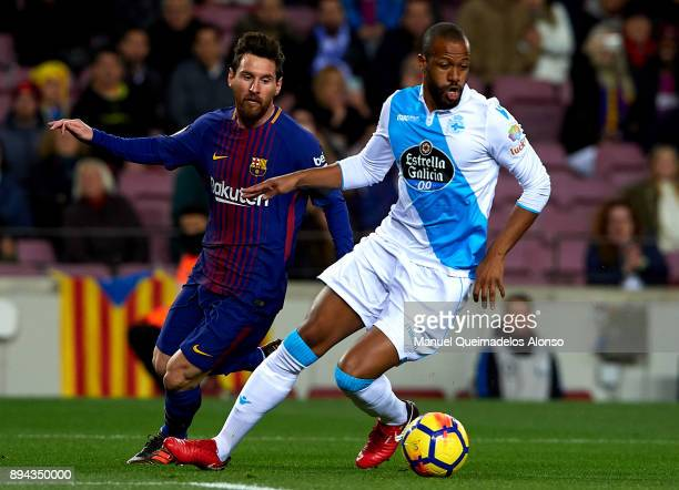 Lionel Messi of Barcelona competes for the ball with Sidnei Rechel of Deportivo de La Coruna during the La Liga match between Barcelona and Deportivo...