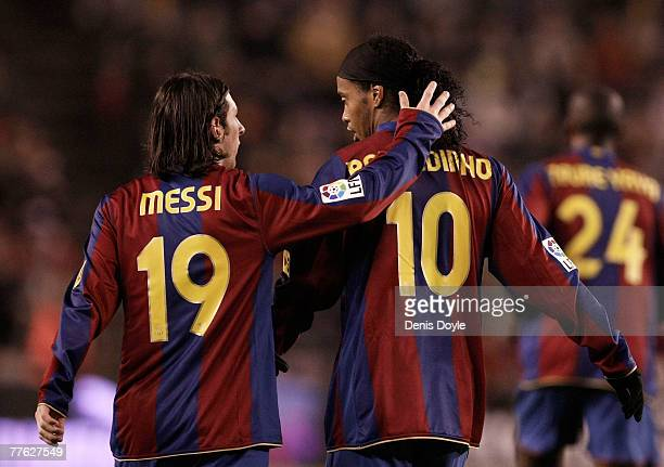 Lionel Messi of Barcelona congratulates Ronaldinho after he scored Barcelona's first goal during the La Liga match between Valladolid and Barcelona...