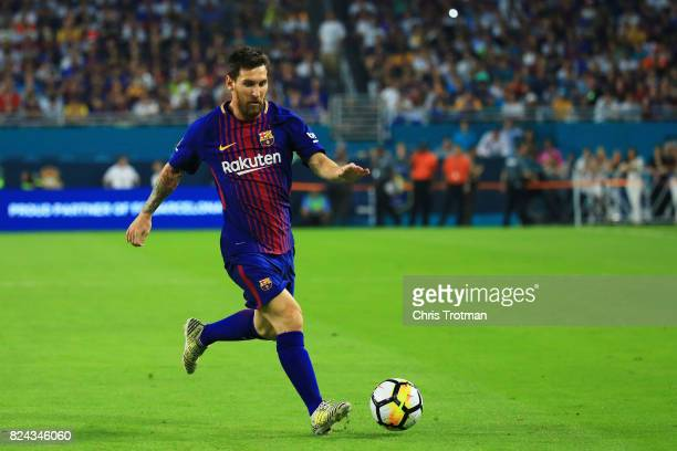Lionel Messi of Barcelona controls the ball against Real Madrid in the first half during their International Champions Cup 2017 match at Hard Rock...