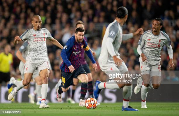 Lionel Messi of Barcelona controls the ball against the Liverpool players during the UEFA Champions League Semi Final first leg match between...