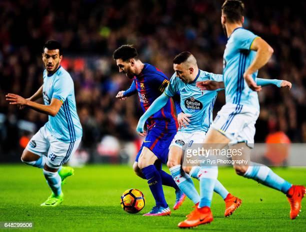 Lionel Messi of Barcelona controls the ball as Iago Aspas of Celta defends during the La Liga match between FC Barcelona and RC Celta de Vigo at Camp...