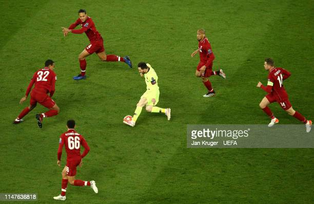 Lionel Messi of Barcelona controls the ball from Trent AlexanderArnold Joel Matip Virgil van Dijk Fabinho and Jordan Henderson of Liverpool during...