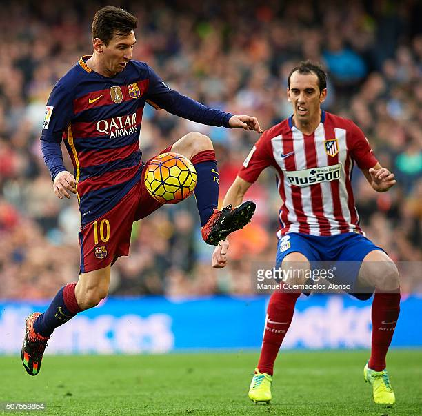 Lionel Messi of Barcelona controls the ball next to by Godin of Atletico de Madrid during the La Liga match between FC Barcelona and Atletico de...