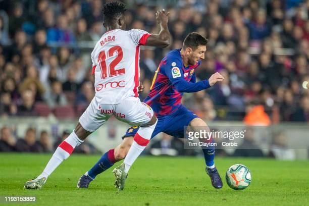 Lionel Messi of Barcelona defended by Iddrisu Baba of Mallorca during the Barcelona V Mallorca La Liga regular season match at Estadio Camp Nou on...